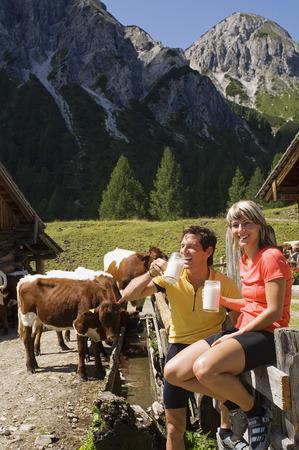 Austria, Salzburger Land, Couple Drinking Milk