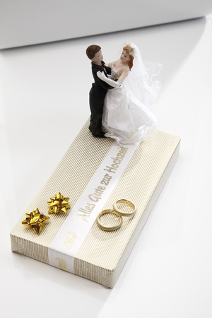 Wedding Couple Figurines Standing On Wedding Present, Elevated View LANG_EVOIMAGES