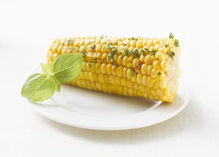 Corncob With Herb-Flavoured Butter On Plate