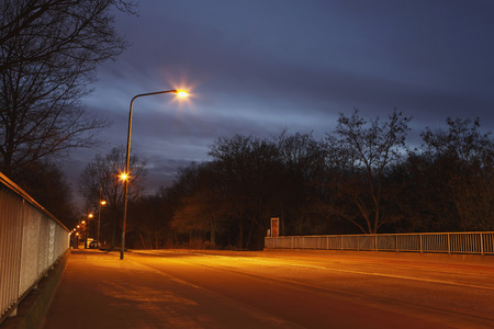 Bridge At Night With Street Lamps