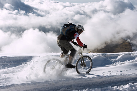 Spain, Sierra Nevada, Mountainbiking Across Snow LANG_EVOIMAGES