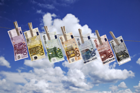 Different Euro Bank Notes Hanging On Clothesline Against Cloudy Sky