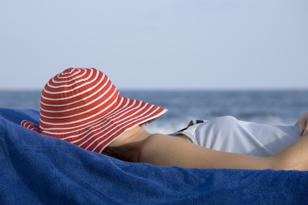 Woman With Hat, Lying On Beach