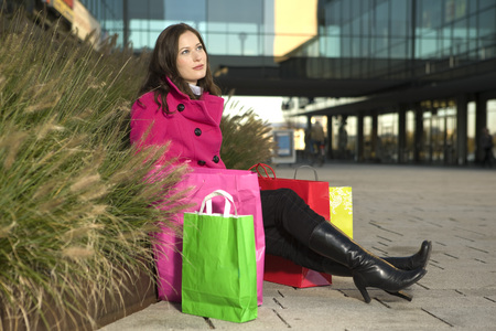consumerism: Woman With Shopping Bags, Sitting