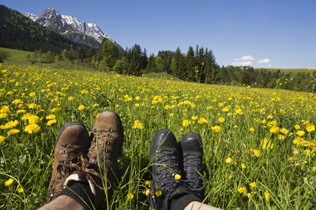 Austria, Tyrol, Kaisergebirge, Hikers Relaxing On Meadow, Close-Up