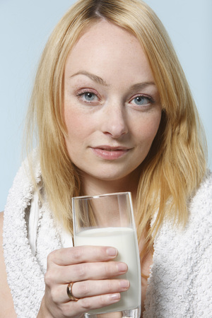vitamin rich: Young Woman Drinking Glass Of Milk, Portrait