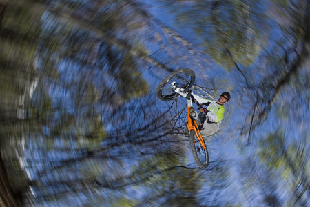 Italy, Lake Como, Mountain Biker Taking A Jump, Low Angle View