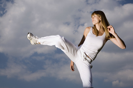 Young Woman Practicing Martial Arts LANG_EVOIMAGES