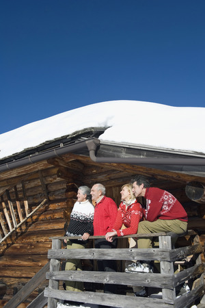 Italy, South Tyrol, Seiseralm, Log Cabin, Couple Standing On Balcony
