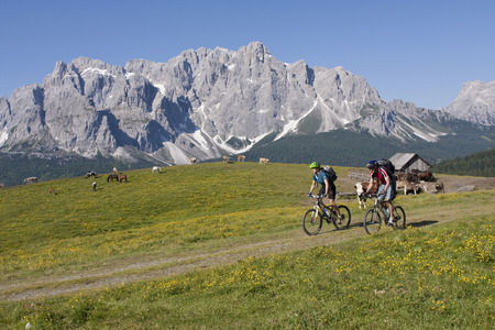 Italy,Dolomites,Couple Mountainbiking
