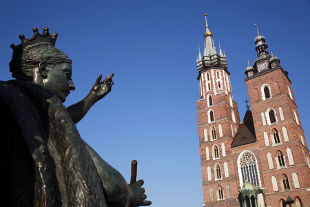 Poland,Cracow,St Marys Church And Sculpture In Foreground