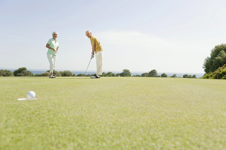 Spain,Mallorca,Senior Couple Playing Golf LANG_EVOIMAGES