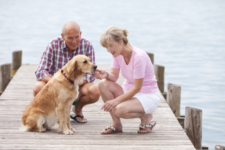 Germany,Bavaria,Starnberger See,Senior Couple With Golden Retriever On Jetty