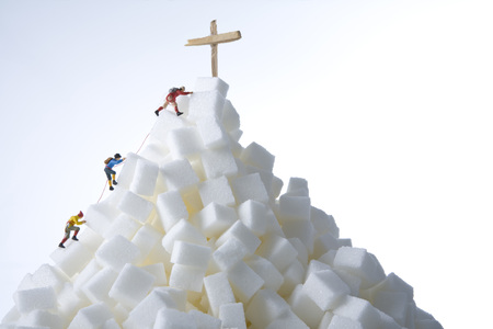 Plastic Figurines Climbing A Mountain LANG_EVOIMAGES