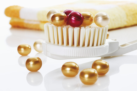 Bath Pearls On Brush With Towel In Background