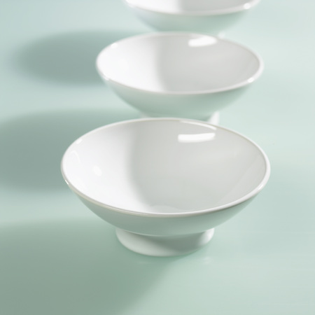 Row Of White Bowls On Coloured Background