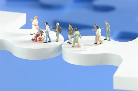 Plastic Figurines On Puzzle Pieces