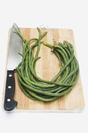 vigna: Asparagus Beans On Chopping Board