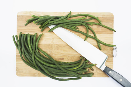 vigna: Asparagus Beans On Chopping Board,Elevated View LANG_EVOIMAGES
