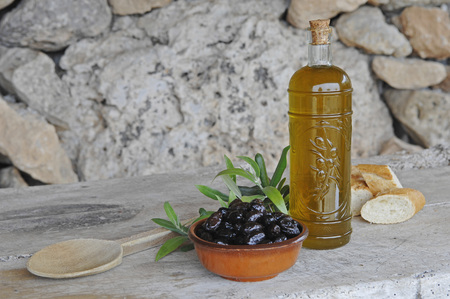 Black Olive In Bowl With Olive Oil And White Bread