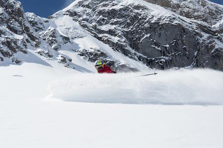 Austria,Arlberg,Man Skiing Downhill LANG_EVOIMAGES