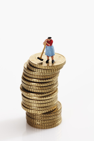 Woman Figurine Cleaning Stack Of Coins