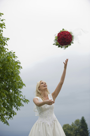 Bride Throwing Up Bouquet,Smiling LANG_EVOIMAGES