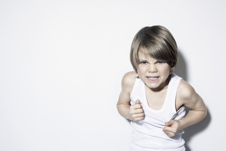 Boy (8-9) Clenching Teeth,Close-Up,Portrait
