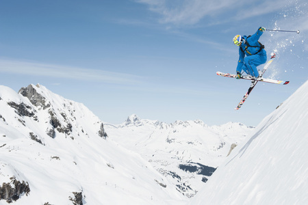 Austria,Arlberg,Man Skiing Downhill,Doing Jump