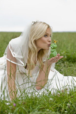 Bride Kissing Toy Frog,Looking Away LANG_EVOIMAGES