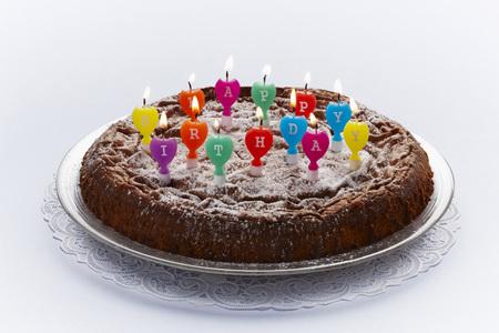 Birthday Cake With Burning Candles On White Background