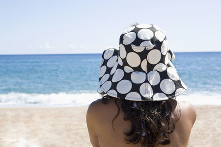 France,Corsica,Woman Relaxing On Beach,Rear View LANG_EVOIMAGES