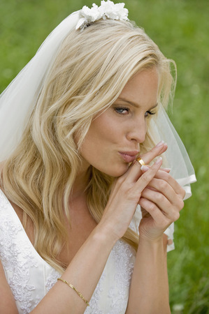 Bride Kissing Her Wedding Ring