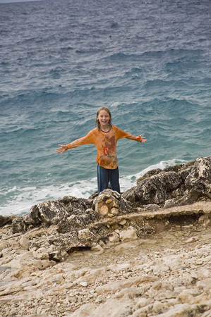 Croatia,Korcula,Girl (8-9) Standing By Sea,Smiling,Portrait LANG_EVOIMAGES