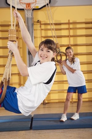 Germany,Emmering,Girls(12-13)  Hanging From Gymnastic Rings,Smiling,Portrait