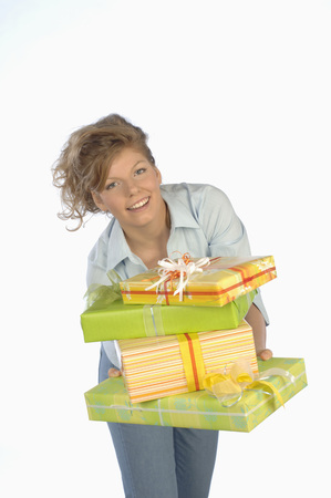 Young Woman Holding Gift Packages,Smiling,Portrait