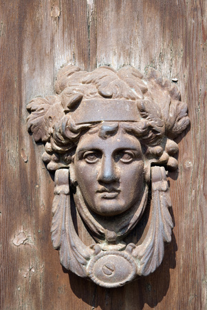 France,Alsace,Old Copper Door Knocker With Human Face On Wooden Door LANG_EVOIMAGES