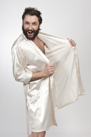 Man Wearing Silk Robe,Pulling Face LANG_EVOIMAGES