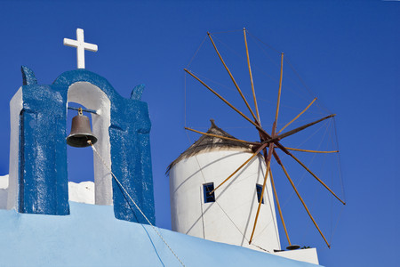 Europe,Greece,Aegean Sea,Cyclades,Thira,Santorini,Oia,View Of Bell Tower And Wind Mill