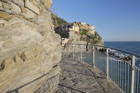 Italy,Cinque Terre,La Spezia Province,Manarola,Liguria,View Of Traditional Fishing Village And Walkway