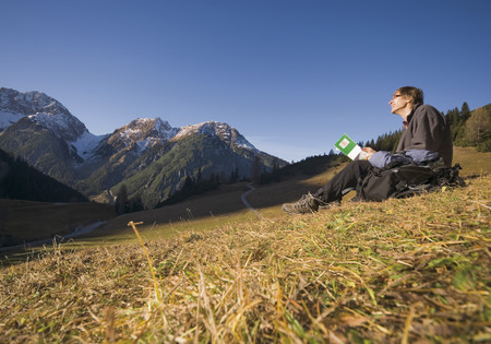 Austria,Man Hiking At Mountains LANG_EVOIMAGES