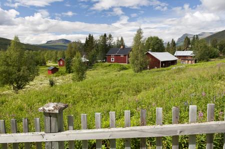 Sweden,Lapland,Fence And Cottages In The Community Of Kvikkjokk LANG_EVOIMAGES