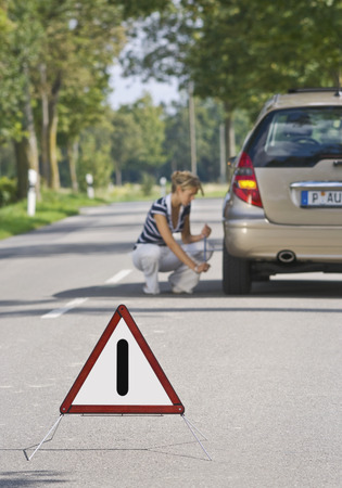 Germany,Augsburg,Young Woman Repairing Puncture LANG_EVOIMAGES