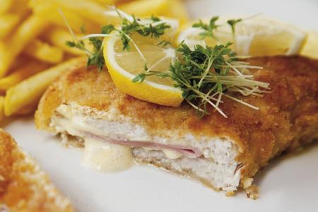 Cordon Bleu With Potato Fries And Sauce Hollandaise,Close Up