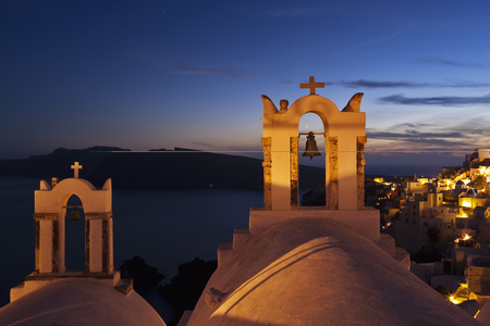 Greece,Cyclades,Thira,Santorini,View Of Bell Tower And Oia After Sunset