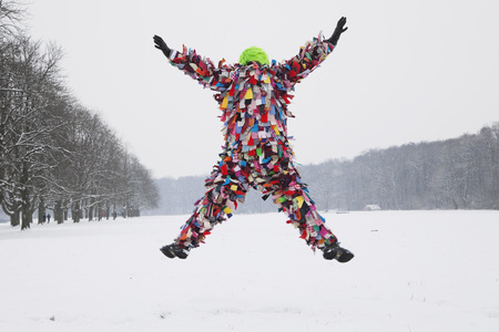 Germany,Cologne,Senior Man In Traditional Costume Jumping