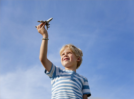 Germany,Bavaria,Boy (4-5 Years) Playing With Toy Airplane