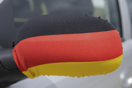 Germany,German Flag On Wing Mirror Of Car LANG_EVOIMAGES