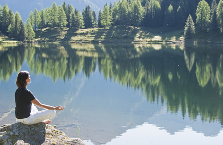 Austria,Styria,Mid Adult Woman Meditating At Lake Duisitzkar In Schladming LANG_EVOIMAGES