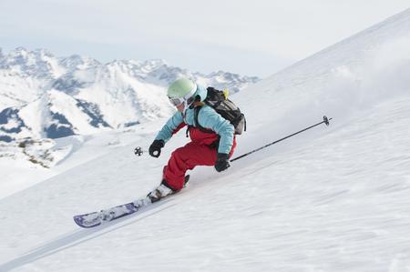 Austria,Kleinwalsertal,Woman Skiing LANG_EVOIMAGES